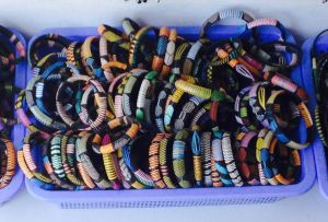 Plastic woven bangles made in Senegal.