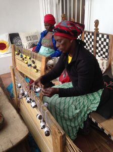 Women weaving for a collaborative project with a French NGO, outside Binky's home or Design Afrika's Headquarters.