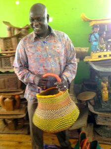 Sillah holds one of the baskets he collected in Ghana.